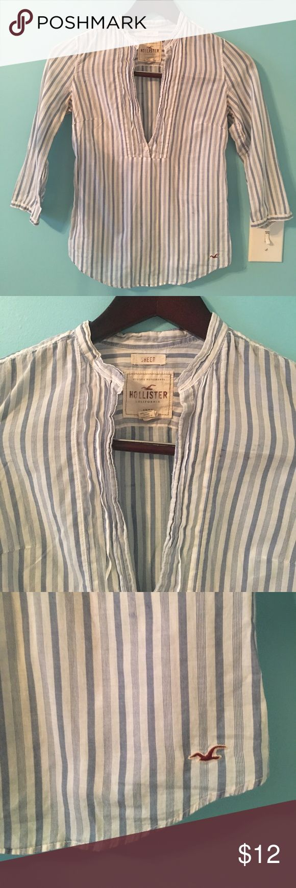 Hollister Cotton blue Striped shirt Very cute and in trend cotton blue striped shirt . 3/4 sleeve, open neckline and elastic at Back waist for a flattering fit Hollister Tops Blouses