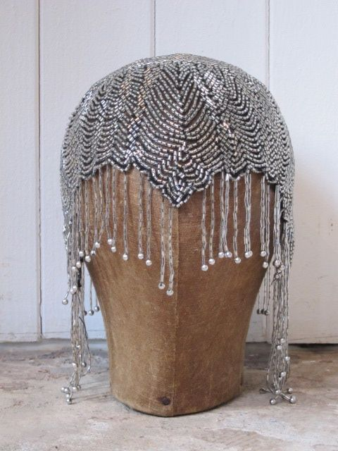 front..1920s vintage head dress in a skull cap style, the glass beads dangle over the eyes