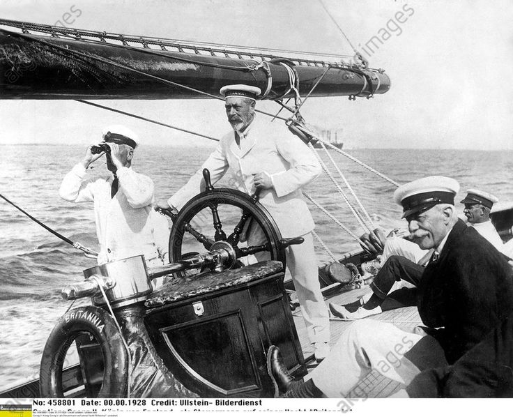 """King George V. at the wheel of his yacht """"Britannia"""", 1928"""