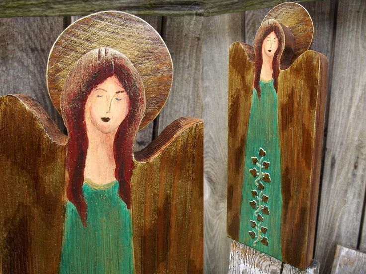 Green wooden angel with ivy