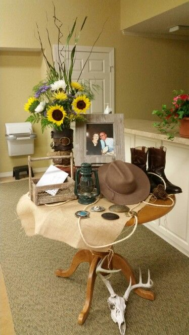 Personalized table I set up for my father-in-law's memorial service. Used his belts to surround glass vase for the floral arrangement.