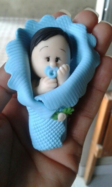 Bebê na mantinha