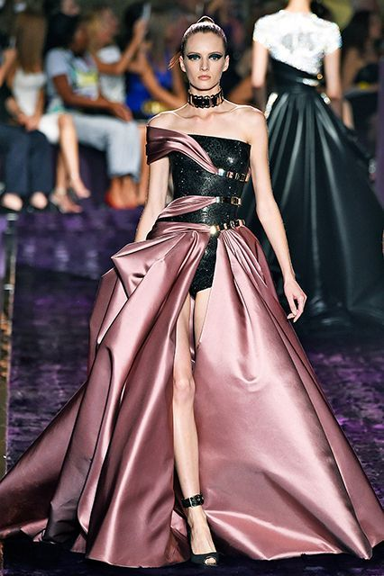 Atelier Versace Donatella Versace's '50s-flavored collection reached its fullest realization in this floor-length satin stunner — that still comes equipped with the time-honored Versace bondage-and-buckles motifs.