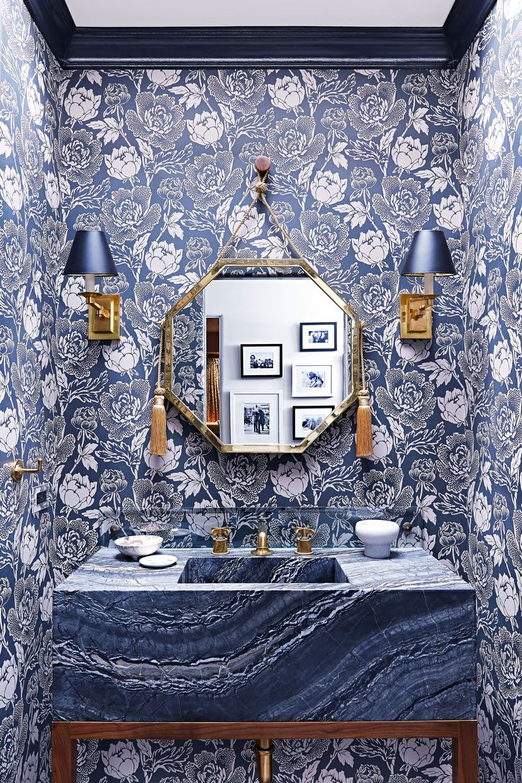 White and blue powder room features walls clad in trim molding framing - A Spanish Style 1920s Bungalow Gets A Modern Makeover