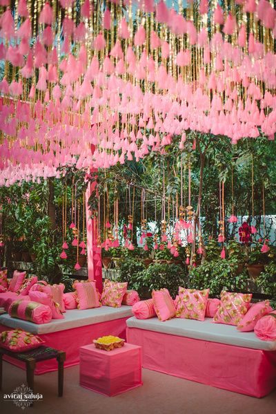 neon pink decor , pink and gold gota decor , pink cushions ,pink seating , cushions , ceiling decor , hanging pom poms , funky decor ideas , pink funky decor , pink mehendi decor , pretty mehendi decor , mornng wedding decor