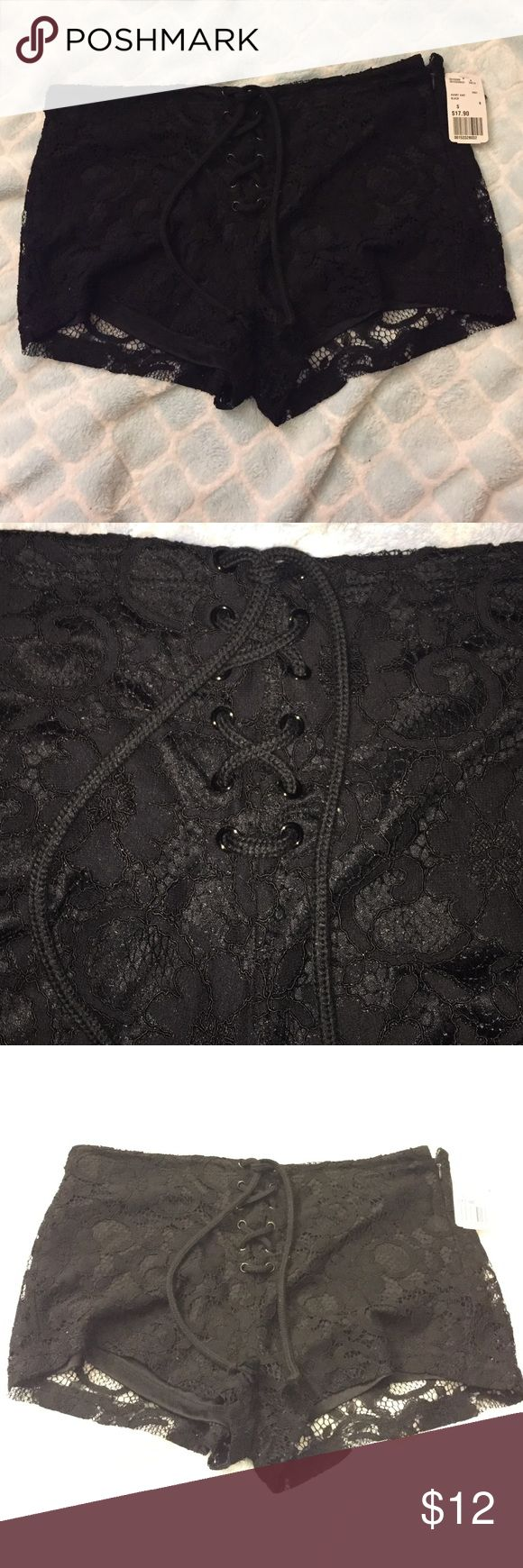 Forever 21 NWT black lace shorts Black lace shorts with lace up front size small. Has a bottom layer so it's not see through. Fits a little loose for a small. New with tags Forever 21 Shorts
