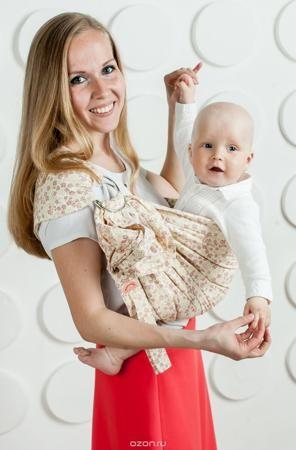 """Мамарада Слинг с кольцами Джая размер S  — 1821р. -------------- Слинг с кольцами позволяет носить ребенка как горизонтально в положении """"Колыбелька"""" так и в вертикальном положении. В слинге в положении """"Колыбелька"""" малыш располагается точно так же, как у мамы на руках, что особенно актуально для новорожденного. Ткань слинга равномерно поддерживает спинку малыша по всей длине. Малышу комфортно и спокойно рядом с мамой. Мама в это время может заняться полезными делами или прогуляться. В…"""