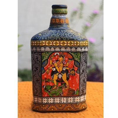 "No longer ""just a glass bottle"".. Pattachitra decoupage on bottle."