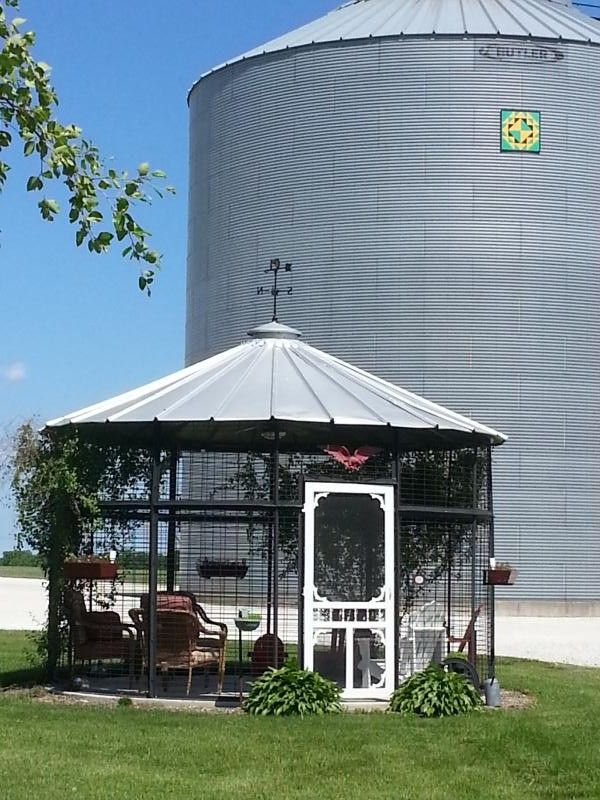 Love this corn crib gazebo, and even the quilt block hanging on the new bin in the back!