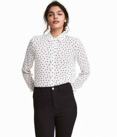 White/hearts. Long-sleeved blouse in woven fabric with gathered yoke at back, cuffs with buttons, and slits at sides. Slightly longer at back.