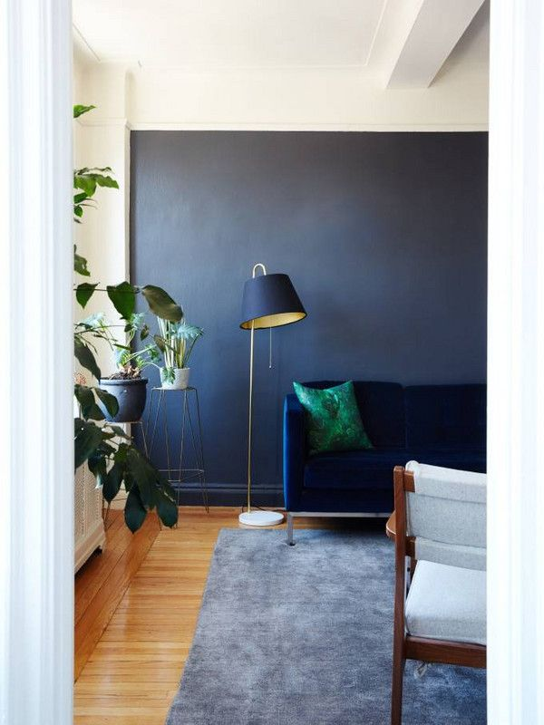 best interior design blogs living room with dark navy accent wall