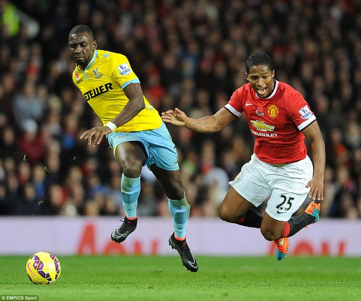 Yannick Bolasie tries to escape from Antonio Valencia, who was back on the right side of defence again as United coped with injuries