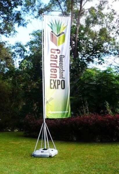 Portable flag pole for a garden expo.