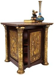 This generously-sized Egyptian Revival table is more than two feet wide and just as high, creating a versatile work of furniture art crafted in wood with inset bas-relief resin panels. Flanked by ornate columns, a door covered with hieroglyphics opens to reveal a single shelf for storage. Finished in faux gold leaf, this is a true statement piece recalling ancient dynasties!