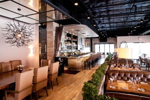 The bricked walls offer an ode to the original structure while the modern fixtures and greenery breathes a tone of vibrancy and sophistication. Oak Restaurant, Dallas