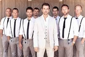 i konda like this idea... the groom standing out from the groomsmen.... but i think he would be wearing one of those vests