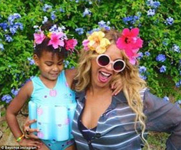Flower child: Blue, who is Beyonce and Jay Z's only child, is pictured here with her famous mother