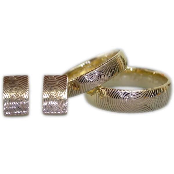 Hele bijzondere trouwringen met vingerafdruk en bijpassende oorstekers. Verkrijgbaar bij Circles in Zwijndrecht.