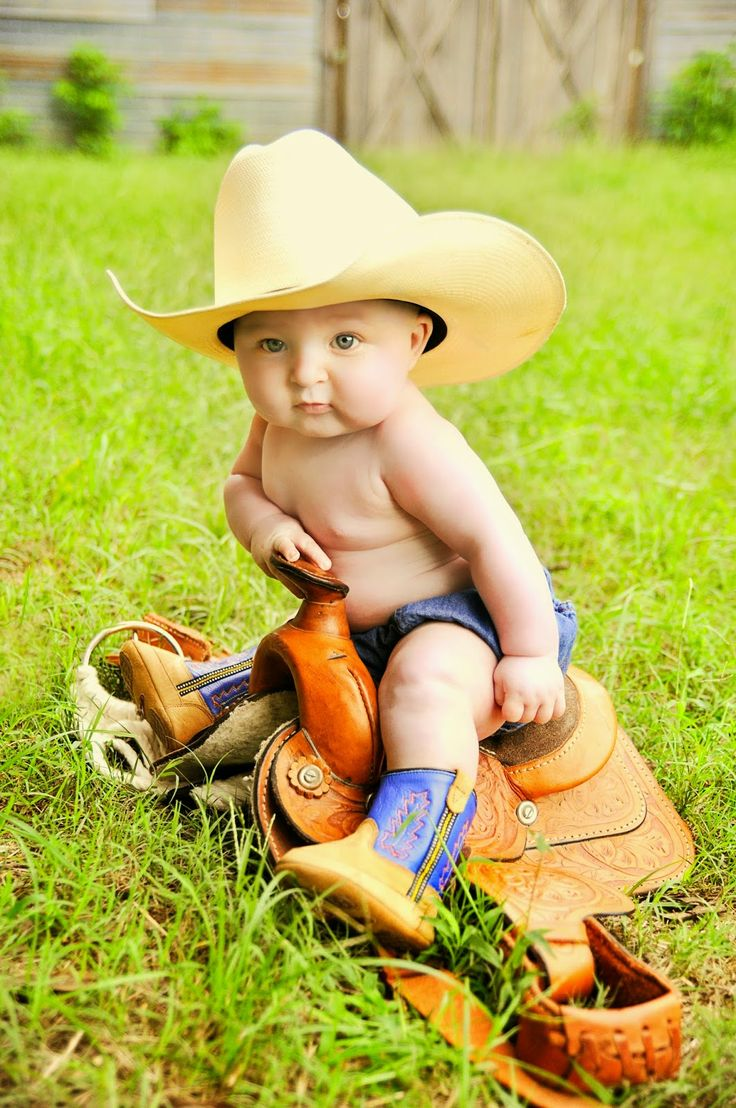 four 4 month old cowboy baby picture portraits with a little, tiny, baby saddle!!! :)