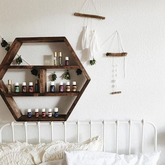 We at Wood&Oils believe that storing your oils should be effective as well as decorative. This handmade, individually stained solid wood hexagon essential oil storage can be hung (comes attached with 2 hangers) or displayed on a table/dresser. The shelving can store all oils 5mL and up, as well as most rollers and sprays (as pictured in photos).  Since each box is made to order, slight variations may occur in wood grain, darkness of stain, etc. We personally hand make and design each...
