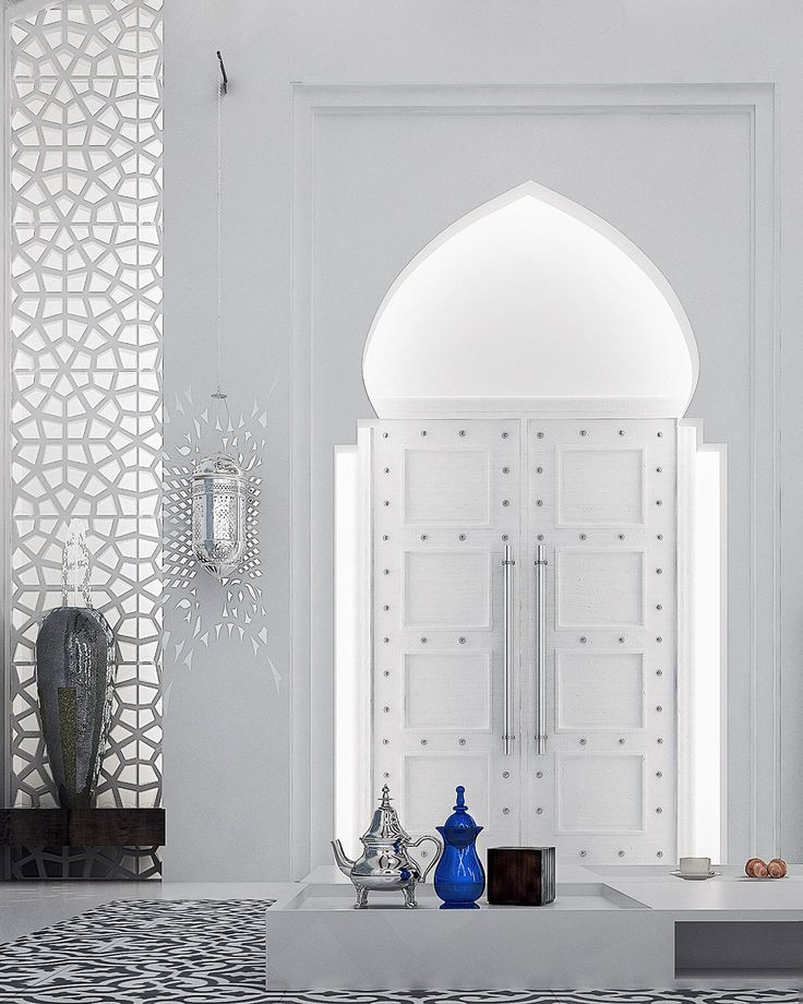 The horseshoe arches are extremely common in Moroccan design and are characterized by a large round arch atop a straighter, narrower doorway (or in this case, indentation). In fact, they may also be referred to as Moorish arches (or keyhole arches).