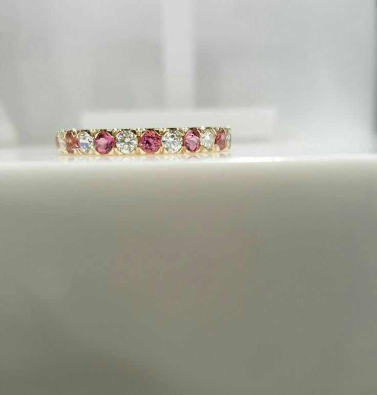 Custom made ring with pink sapphires and diamonds