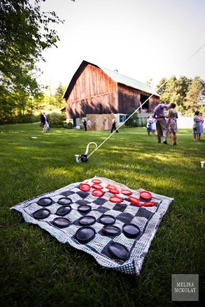 Yard Games: Oversized Board Games Creating a giant checkers board couldn't be easier — just get a checkered blanket and plastic plates or Frisbees in red and black
