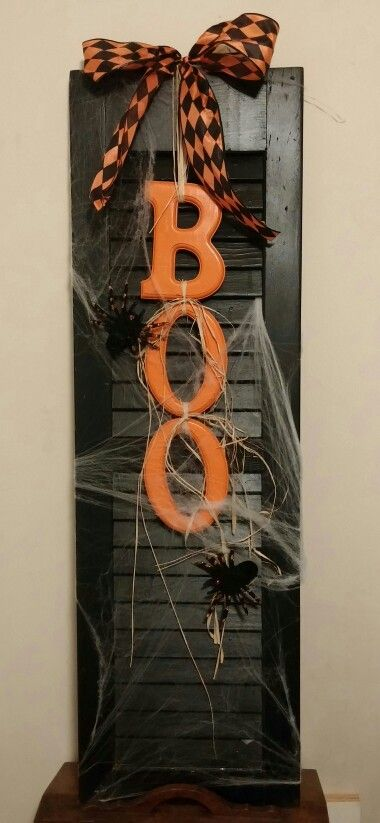 Black wooden Boo shutter for halloween. No link