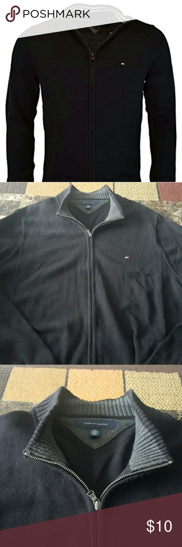 Tommy Hilfiger zip up sweater Black zip up sweater,  long sleeve does have a tear along the pocket, can be sowed back up for anyone that knows how, orther than that its in great condition the black photographs dull but its still a bright black FIRST PICTURE JUST A LOOK A LIKE SIMILIR DESIGN Tommy Hilfiger Sweaters Zip Up