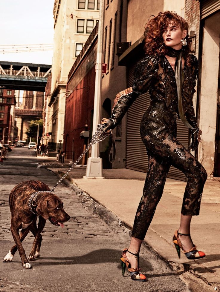 Posing with a dog, Catherine McNeil wears Rodarte sequined top and pants with leather shoes, earrings and glove for Allure Magazine December 2016 issue