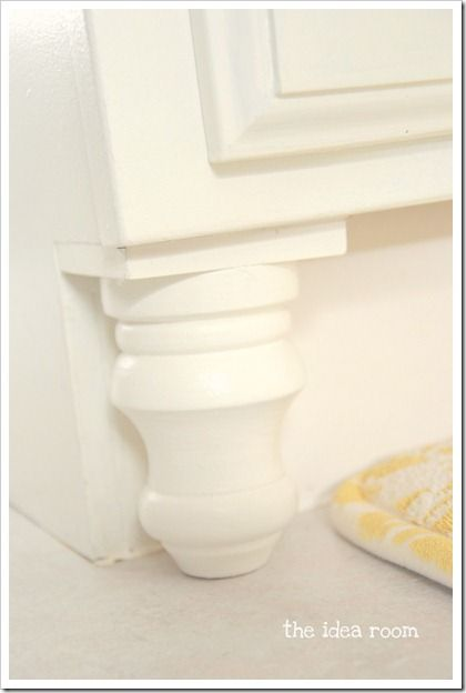 Updating builder grade bathroom cabinets with finial feet