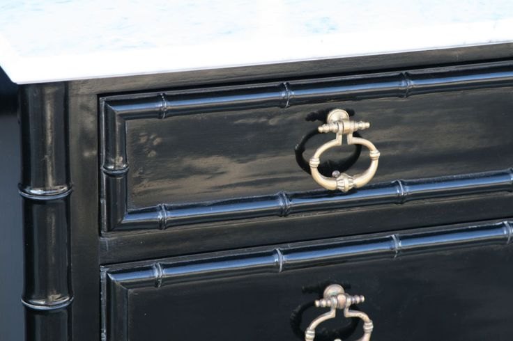 polished black lacquer faux bamboo dresser.
