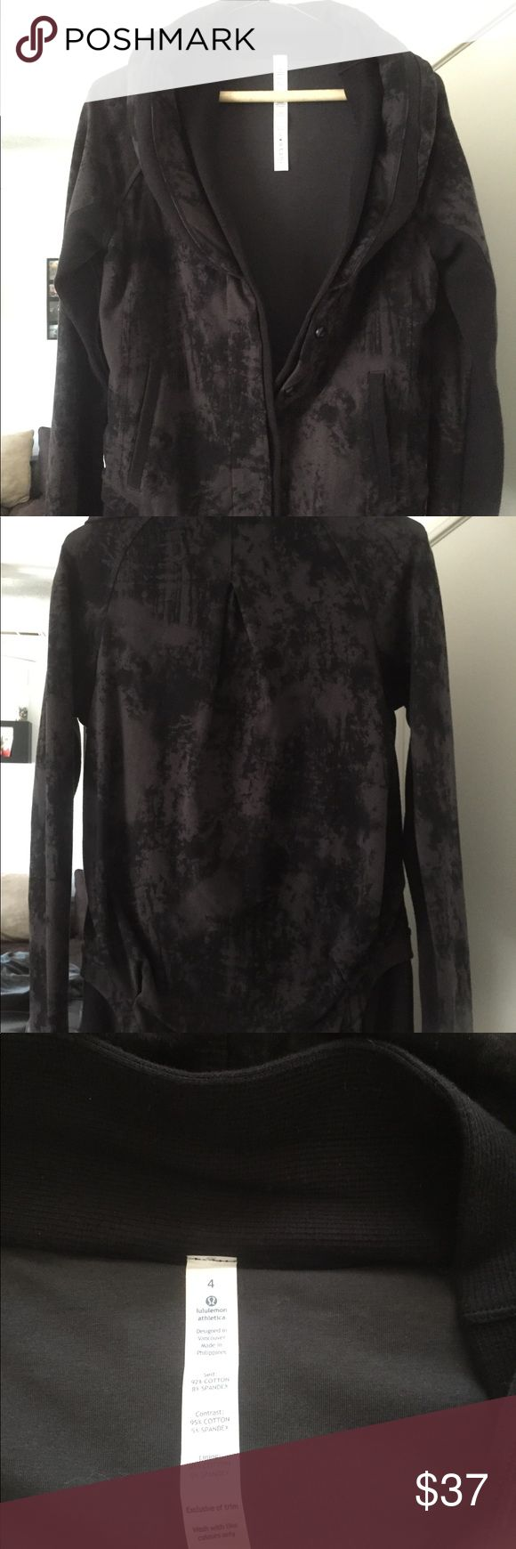 Lululemon jacket Black Lululemon jacket.  Button down.  New w/o tags.  Never been worn.  Got it during an online warehouse sale and never wore it.  Thumb holes in sleeve, folded collar.  Marble black color lululemon athletica Jackets & Coats Utility Jackets