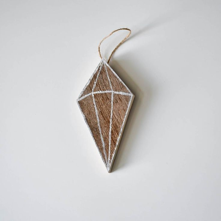 Shine bright like a  diamond! A little geometric gem painted on barn board to start your Sunday off beautiful!  This little crystal is going to look gorgeous hanging on someone's tree!      #shiny #imsoshiny #geometric #gem #crystal #barnwood #barnboard #reclaimed #rustic #vintage #christmasmarket #Christmas #marketprep #twine #ornament #treeornament #homedecor #homesweethome #vintagemodern #barnstyle #woodwork #womenwhowoodwork #womenwithtools #winterishere # # #HistorymeetHandmade