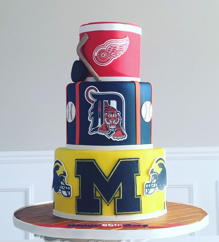 Sports cake with redwings, u of m footballs d Detroit Tigers