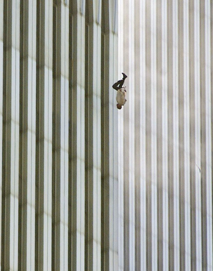 """The falling man"" by Richard Drew, New York World Trade Center, 11th September 2001.  The events do not need any explanation.  The power of this pictures lies in the almost unbearable contrast between the pureness of the vertical lines which convey serenity, calmness and the terrible tragedy ""in fieri"", emphasised by the false stillness and composed posture of the subject."