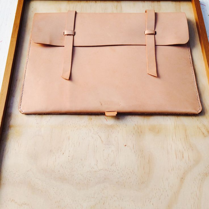 """MacBook """"11 folio all leather in a natural finish. Saddle stitched throughout with linen cord."""