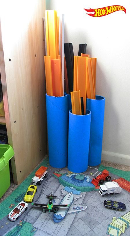 Reuse old paint tubes for a quick and colorful way to keep Hot Wheels Track together and avoid losing cars.