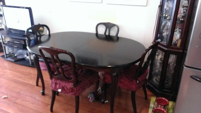 Bring some old-world charm into your home with this antique dining room table! Restained, sturdy, and beautiful.
