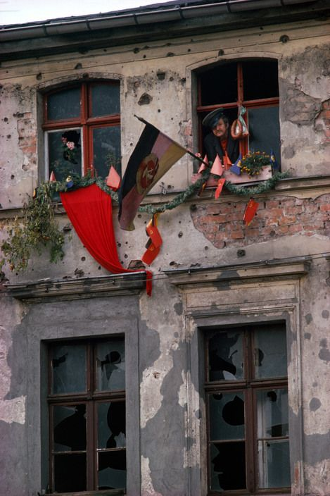 Magnum Photos — Thomas Hoepker — Bautzen, 1974. Dilapidated house in Bautzen during an official festivity.