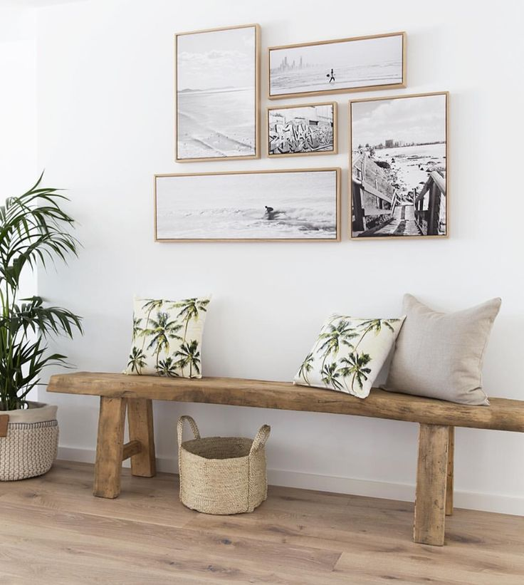 Wall styling for a laid back beachy boho vibe, framed art in black and white, tropical prints, rustic bench
