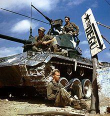 Korean War - Crew of an M-24 tank along the Nakdong River front, August 1950
