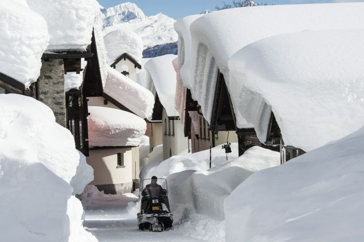 Feb. 9, 2014. Snow masses pile up on the rooftops of the village of Bedretto, Ticini,  Switzerland.
