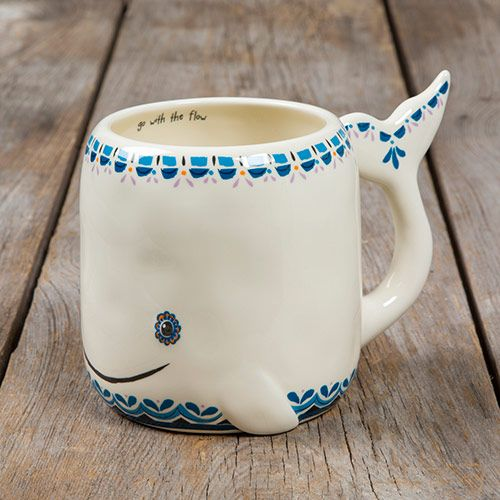 This folk art mug in an adorable whale designreminds you to 'go with the flow' each time you pick it up. Hand sculpted, ceramic mug is microwave and dishwasher safe. $16.95