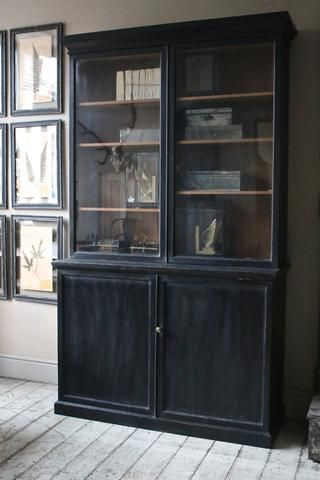 Furniture: Vintage Bookcase in entryway - open shelves for display, storage below for gloves/hats, etc.