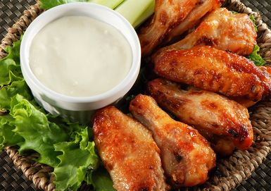 Blue Cheese dip with  Wings - Daniel Loiselle/E+/Getty Images