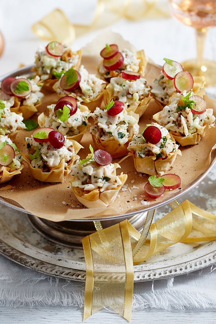 Flaky filo cups are filled with a creamy turkey and celery mix and topped with juicy, sliced grapes for a colouful, and delicious, canape idea for the festive season.