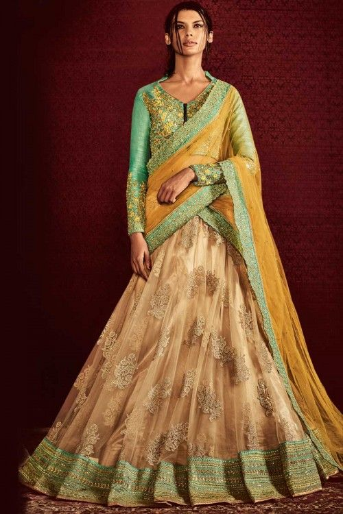 Beige Net Lehenga With Raw Silk Choli Beige net semi stitch lehenga with raw silk choli. This lehenga choli is embellished with embroidered .Product are available in 34,36,38,40 sizes. It is perfect for Festival Wear.   http://www.andaazfashion.co.uk/womens/lehenga-choli