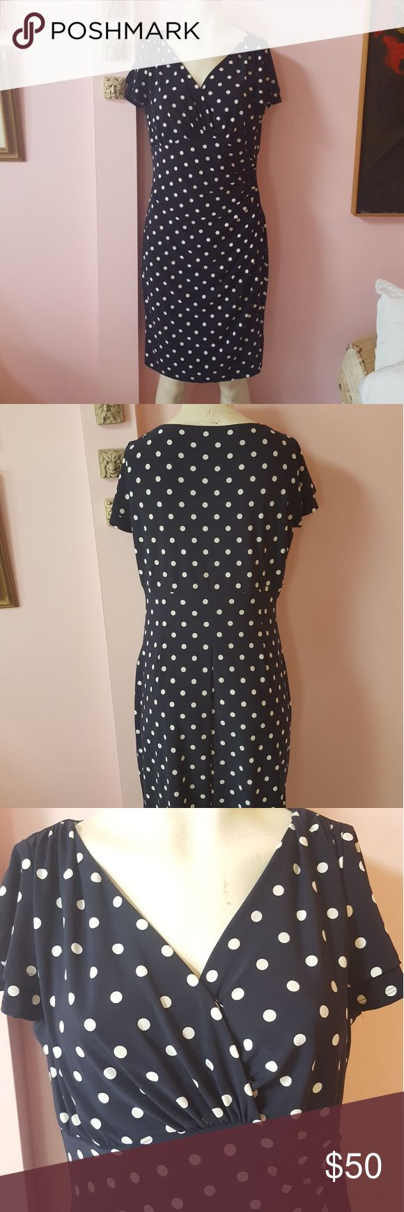 Lauren by Ralph Lauren polka dot dress Lauren by Ralph Lauren polka dot dress This dress gathers on the side looks great on navy blue and white the length is a midi Size 14 petite Perfect for a night out or the office Lauren Ralph Lauren Dresses Midi