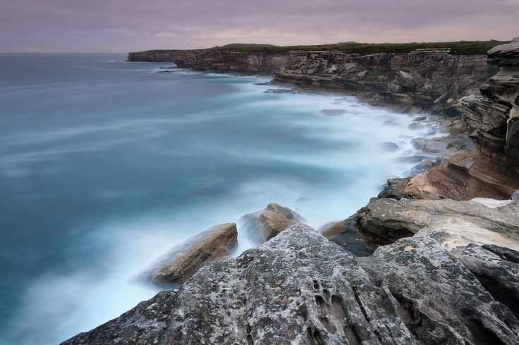 Dawn is a wonderful time of day with interesting light and colours. This photo was taken on the cliff tops at Cape Solander, Kurnell, NSW Australia. The tripod was less than 30cm from the edge of the cliff and the crashing waves below. The cliffs are sandstone which weathers into interesting shapes with plenty of textures and different colours. http://sdlphotography.com.au